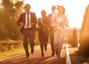 Happy businesspeople running in a park.  [url=http://www.istockphoto.com/search/lightbox/9786622][img]http://dl.dropbox.com/u/40117171/business.jpg[/img][/url]